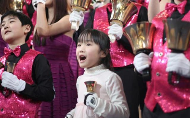 Eileen, 7, is the youngest member of the Bells of Shaughnessy Handbell choir. Her mother, Shan Shan Chen is the leader of the choir in Vancouver, B.C. Photo by Jason Lang, The Vancouver Courier