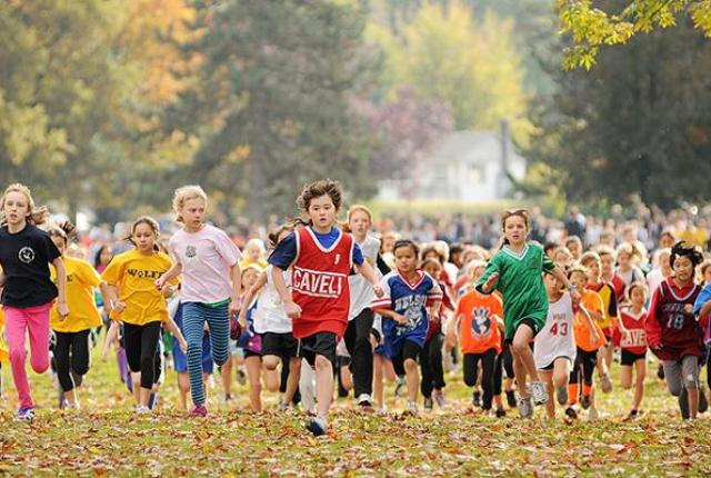 Hundreds of Grade 4 girls take off for the annual elementary school cross-country race at Trout Lake in Vancouver. Photograph by Dan Toulgoet, Vancouver Courier