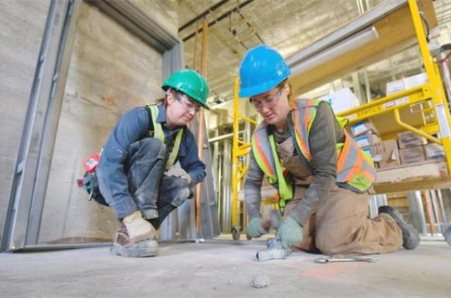 Having a mentor while learning skills is key to successful training. Photograph by Ward Perrin, The Vancouver Sun