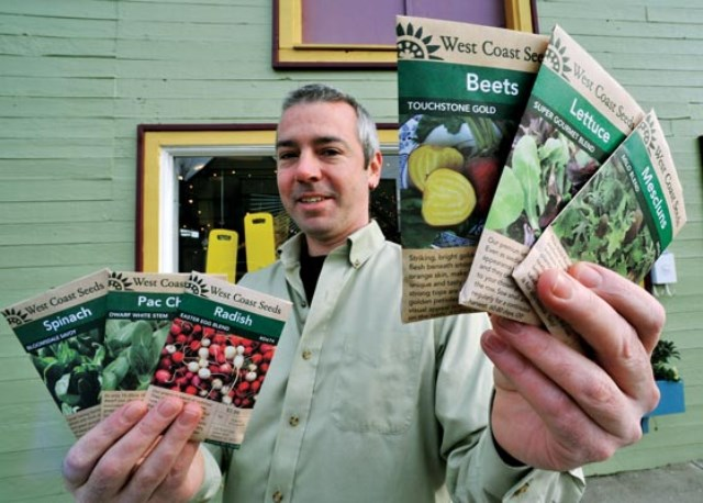 Mark Macdonald shows seed packets. Photo by Ian Smith, The Vancouver Sun