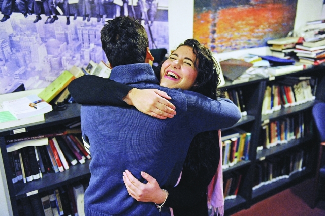 UBC student Sarah of Malta hugs Ziaul of India Photo: Les Bazso, The Vancouver Sun