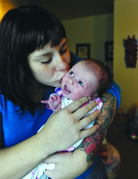 Rachel Suttie, 28, kisses Fern, her 3-week-old baby girl Photo: Jenelle Schneider, The Vancouver Sun