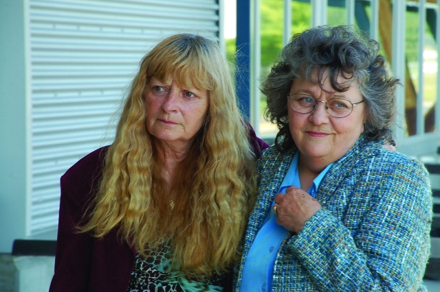 Elaine Campbell, left, stands with her friend at the airport Credit: Spencer Anderson, The Comox Valley Echo