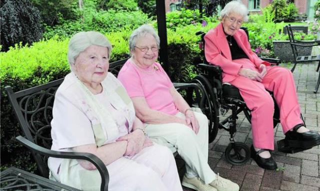 This trio of residents from Parkwood Manor in Coquitlam has been alive for a combined 311 years. From left are: Lillian Gabert, 100, Alice Okerstrom, 105, and Ivy McComb, 106. Photo: Jason Payne, The Vancouver Sun