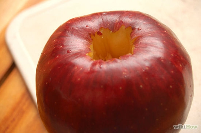"""1. Cut the middle out of the apple. This is called """"coring"""" the apple."""