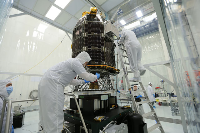 Scientists work on LADEE before the launch. PHOTO - NASA GODDARD PHOTO AND VIDEO/CC, FLICKR