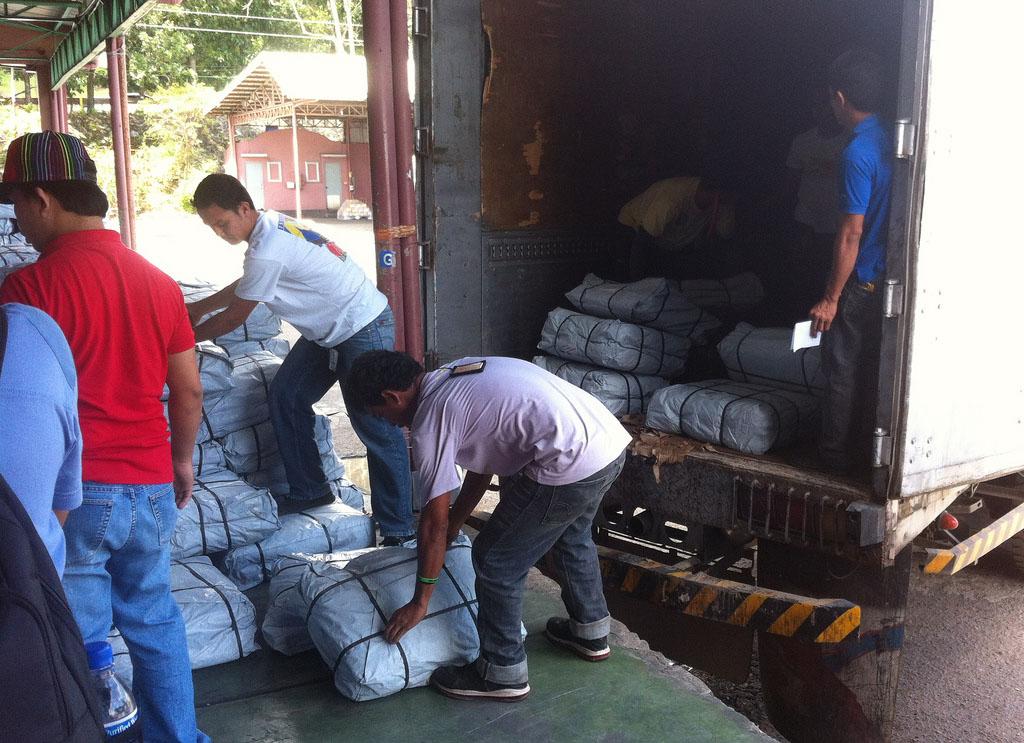 Help is arriving. Shelter kits are loaded onto trucks. PHOTO: DFID--UK DEPT FOR INTERNATIONAL DEV/ CC, FLICKR