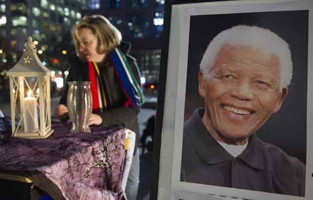 Thousands of people attended Mandela's vigil. PHOTO - GERRY KAHRMANN/VANCOUVER SUN