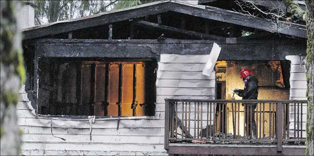 The fire department investigates the fire PHOTO - NICK PROCAYLO, PNG , VANCOUVER SUN
