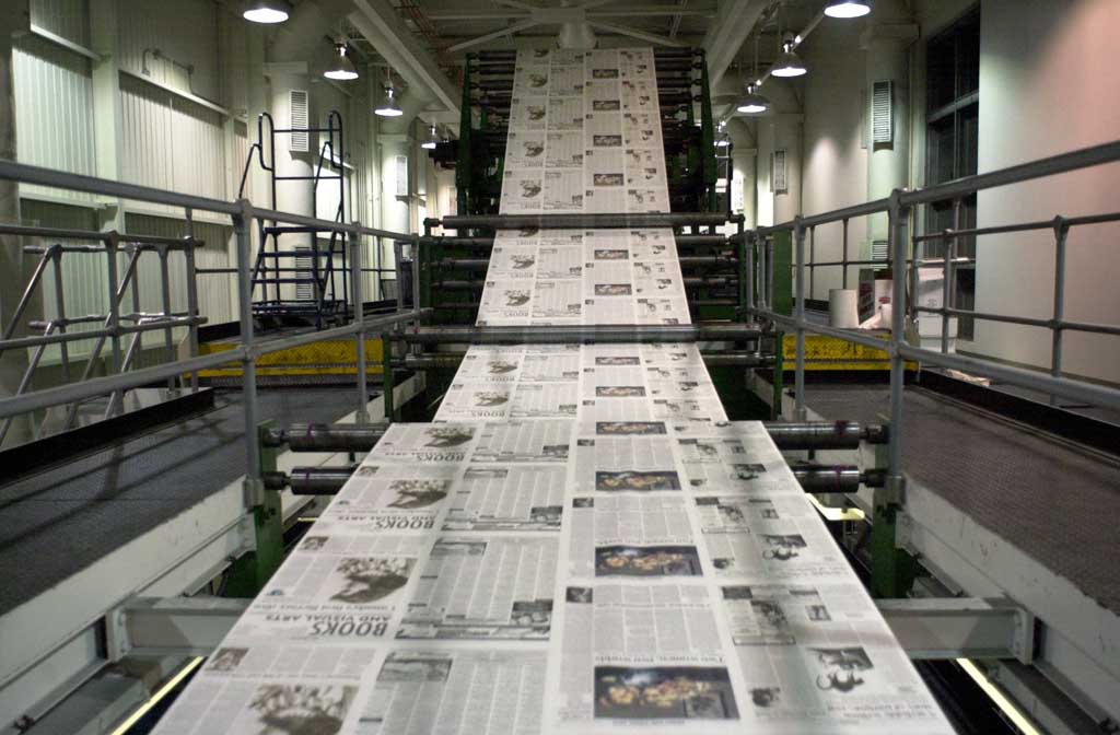 The Kamloops Daily News flows off the press. (Photo: Phil Carpenter / Postmedia News