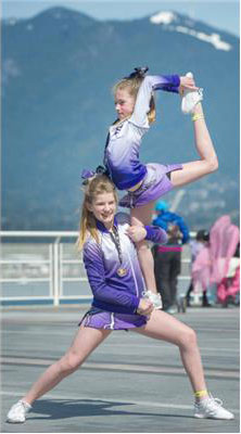 Miller Olson of the Perfect Storm Freeze team holds her sister Alden. (Photo: Arlen Redekop / The Vancouver Sun)