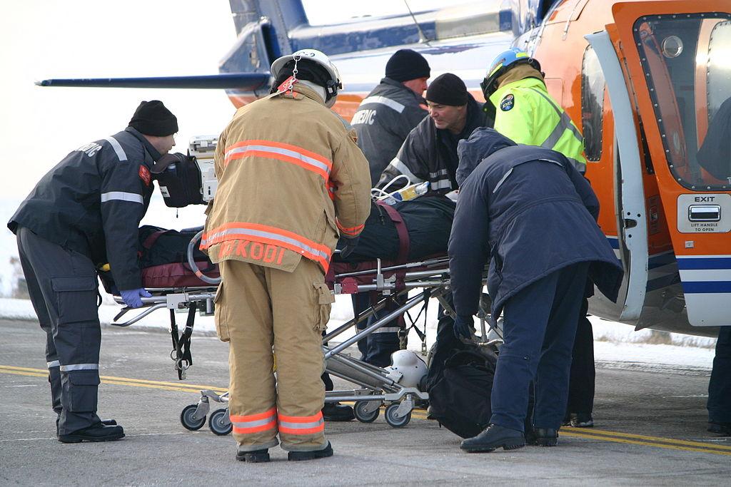 Paramedics help an injured person. Photo: Jason Bain/CC, Wikipedia