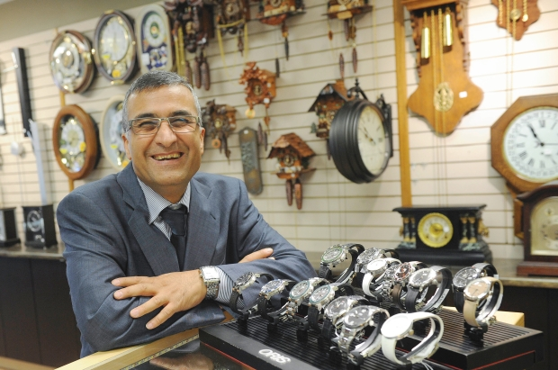 Vahid Yazdanmehr sells many clocks and watches Photo:  Jason Payne/The Vancouver Sun