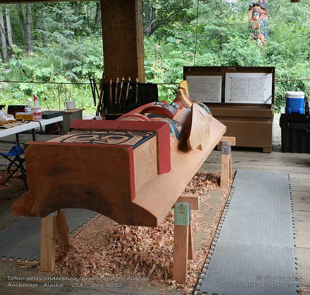 Tim Vo Totem poles undergoing carving and on display