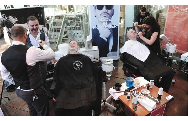 Men in a barber shop at Granville Island. They are getting ready for Movember. Photo by Nick Procaylo/The Province