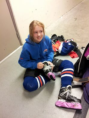 Grace getting into her ringette gear Photo courtesy of Jerrilin Spence