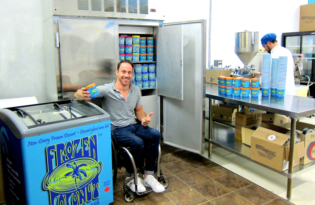 Kevin Carta, co-founder of Frozen Coconut, shows some of the company's products in their warehouse in Richmond. Photo courtesy of Frozen Coconut.