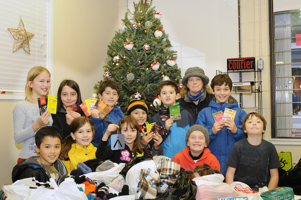 Students from Lord Tennyson Elementary school donate bags of goods. Photo by Dan Toulgoet/The Vancouver Courier