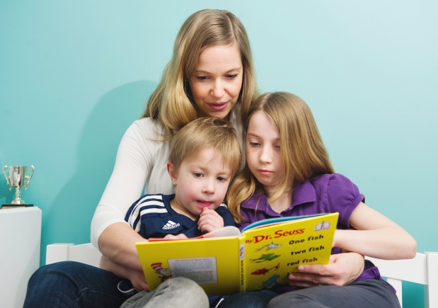 Sheri Brattston reads to her children, Ben and Emma. Photograph by Gerry Kahrmann/The Vancouver Sun