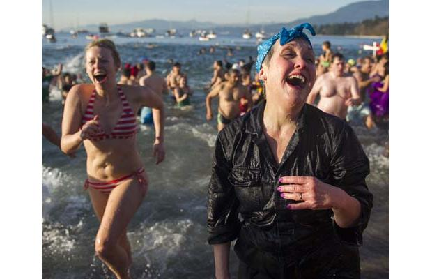 People enjoy dipping in the cold water on New Year's Day. Photo by Gerry Kahrmann/The Province