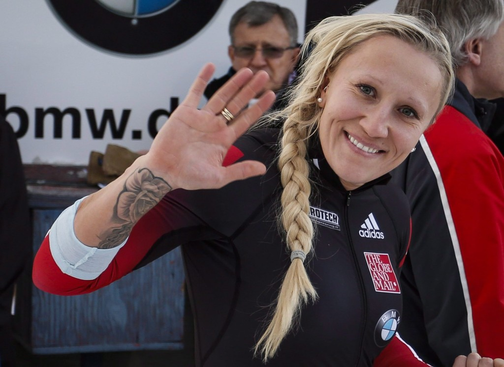 Kaillie Humphries waves to her fans. Photo by Jeff McIntosh/The Canadian Press