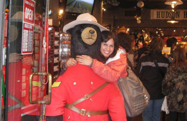 Nas Rafi is a doctor from California. She is hugs a stuffed bear in Gastown. Photo courtesy of The Vancouver Sun