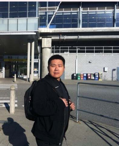 Jerry stands outside a Translink station. Photo by Dora Huang