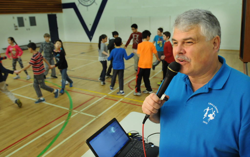 Ray Brendzy calls square dance directions for Grade 4 and 5 students at Sir John Franklin Elementary in Vancouver.  Photo by Dan Toulgoet/The Vancouver Courier