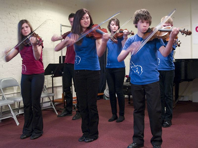 Young people playing fiddles  Photo by Jesi Kelley, CC, Flickr