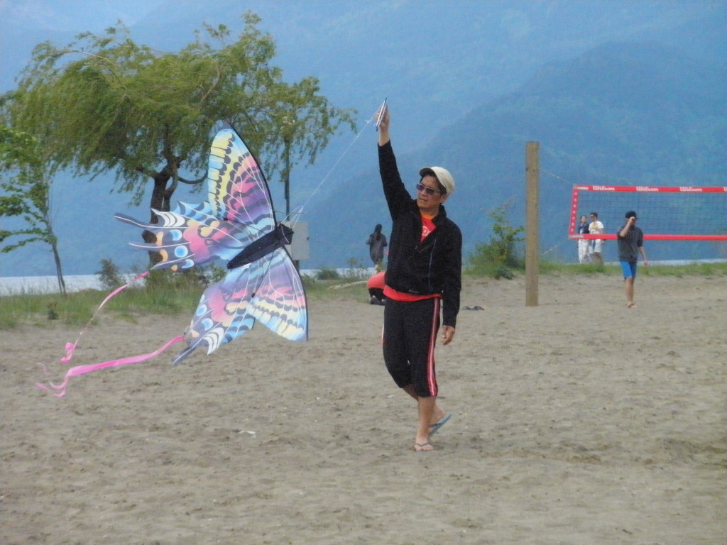 A man is flying a kite. Photo submitted by Bob Luo
