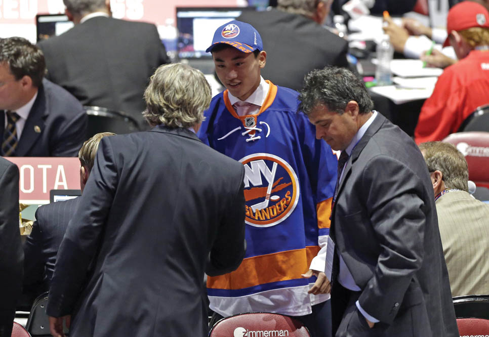 Andong Song shakes hands with NHL bosses. Photo by AP-Alan Diaz/the canadian press