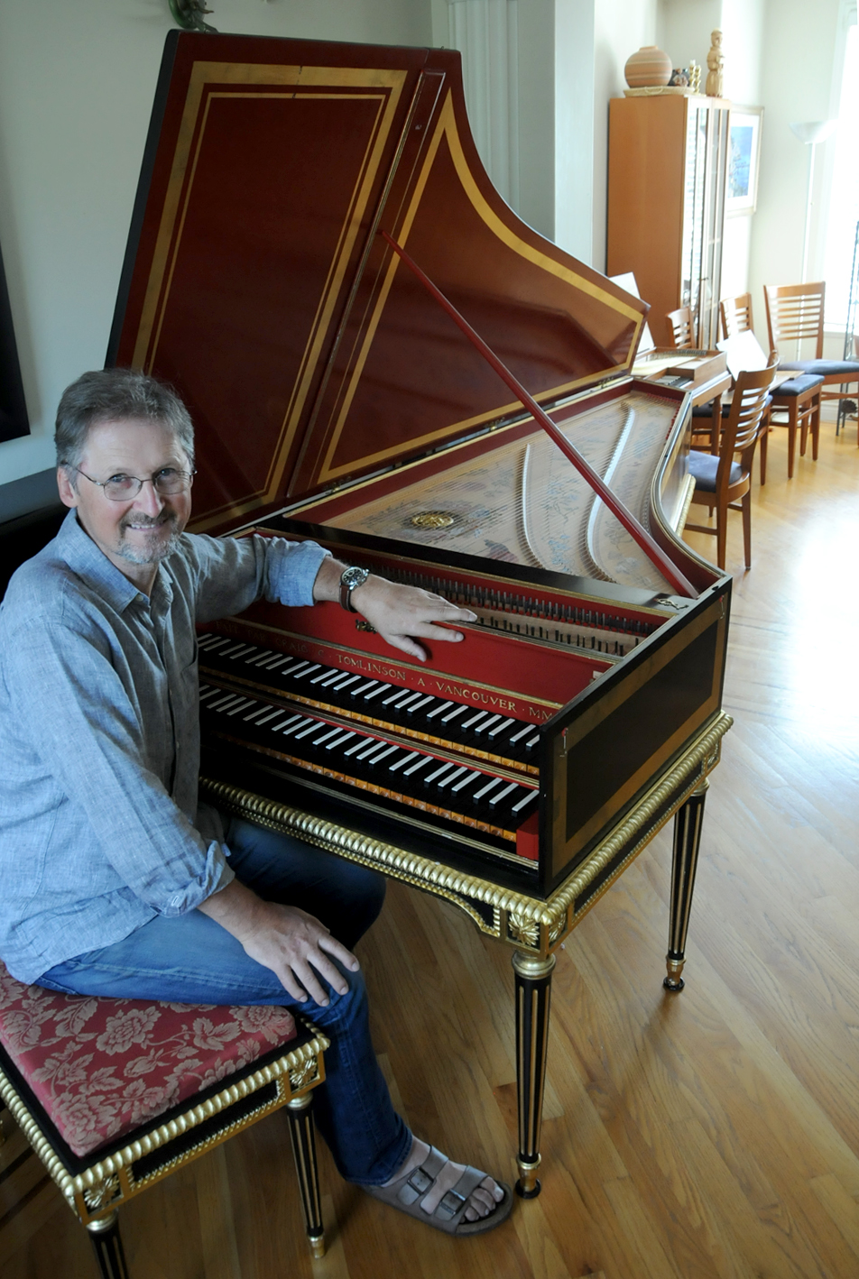 Craig Tomlinson sitting at one of his harpsichords Photo by Mike Wakefield