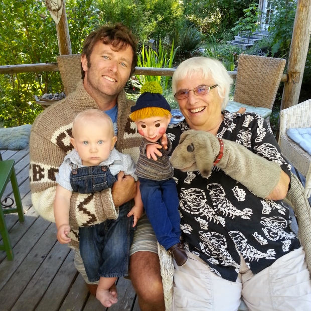 Judith Lawrence with puppets Casey and Finnegan on Hornby Island. Grant Lawrence (no relation), Canadian broadcaster, and son Josh visited her. Photo by Jill Barber