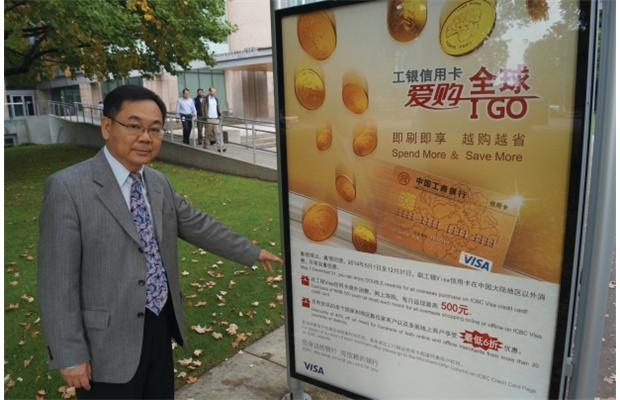 PHOTO – GRAEME WOOD / RICHMOND NEWS / VANCOUVER SUN Chak Au is standing next to a bus shelter in Richmond. The sign is mostly printed in Chinese.