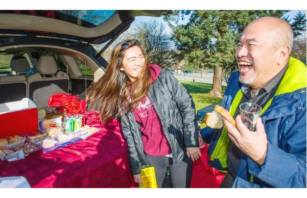 PHOTO - RICK ERNST / THE PROVINCE A family enjoys food at Queen Elizabeth Park. It was a sunny day.