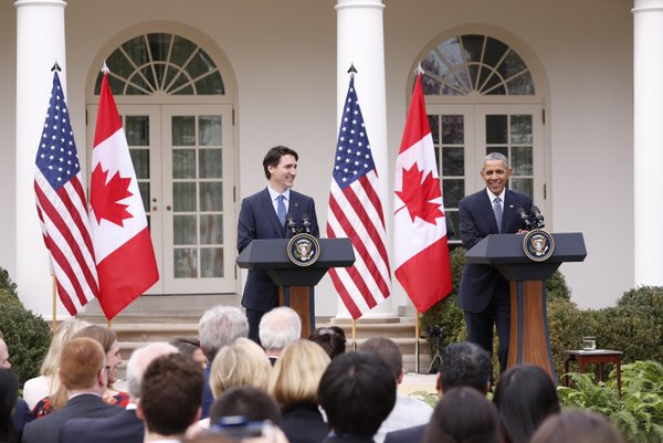 PHOTO: COURTESY THE OFFICE OF THE PRIME MINSTER Prime Minster Trudeau and President Obama talk to the crowd at the White House.