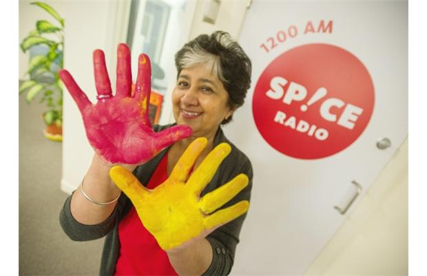 PHOTO – SPICE RADIO VANCOUVER Spice Radio invites you to put a colourful handprint and sign their anti-racism banners.