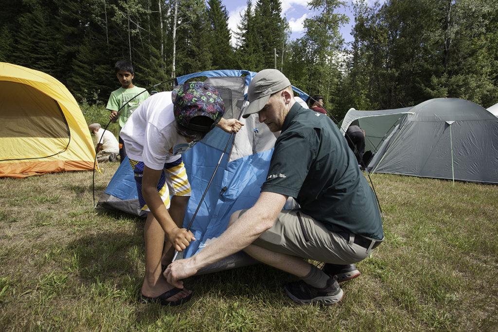 These two are setting up a tent. photo - Parks Canada / Rob Buchanan