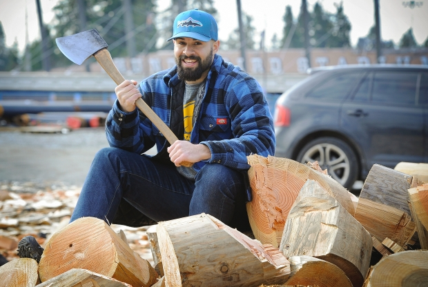 PHOTO: Mark van Manen / The Vancouver Sun CFL player Shea Emry started a new life in logger sports. He likes to swing an axe.