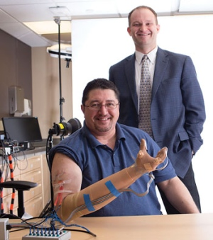 Caption: Igor Spetic, left, and Dustin Tyler. Tyler is the Case Western University biomedical engineer who led the research. Photo by Russell Lee, Courtesy of Case Western Reserve University.