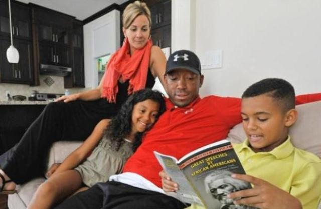 BC Lions' Geroy Simon spends time reading with his kids Jordan (Right) and Jaden and with wife Tracy at their home in Surrey, B.C., Sept 18, 2012. Photo by Arlen Redekop, The Vancouver Sun
