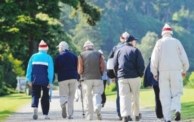 seniors-walking-in-park